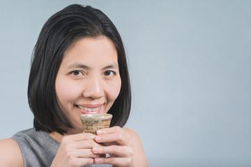 Asian women drinking sake in Hands.