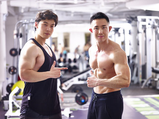 portrait of two young asian bodybuilders