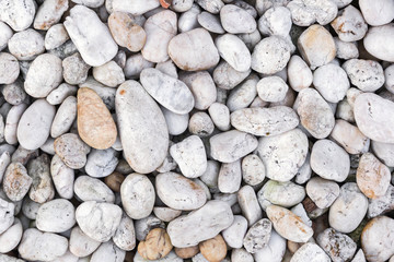 Stone pebbles texture or stone pebbles background for interior design business. exterior decoration and industrial construction idea concept design. Stone pebbles motifs that occurs natural.