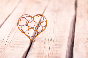 carved wooden heart on a wooden table