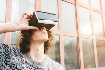 Young man wearing VR glasses