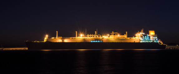 GAS CARRIER - Tanker at the wharf in the harbor at dawn