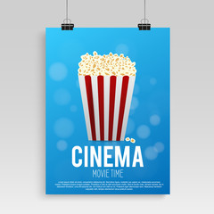 Realistic blue cinema poster in the frame with an image hanging on a textured gray wall, a template for the layout and popcorn. vector illustration