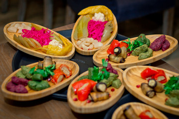 Wooden plate with pickled vegetables