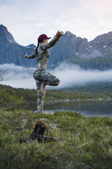 Woman in mountains doing yoga