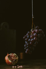 Pictorial fruits still life with grapes and pomegranate.