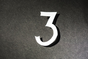 Number three on the black background
