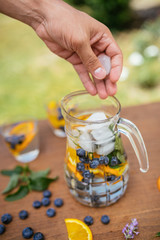 Placing Ice In The Infused Detox Water