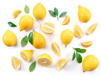 Wall Mural - Ripe lemons and lemon leaves on white background. Top view.