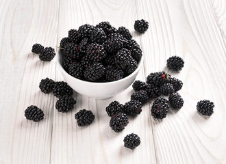 Fresh blackberries in bowl on wooden table. Close up, high resolution product. Harvest Concept