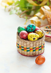 Easter background with Easter eggs in the basket and spring flowers