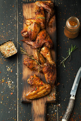Grilled chicken wings with spices and rosemary