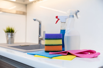 group of cleaning items on home kitchen worktop