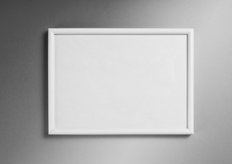 White frame for paintings or photographs on gray background.