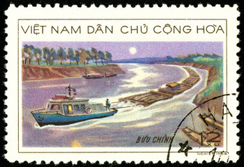 Ukraine - circa 2018: A postage stamp printed in Vietnam shows Wood transportation. Towage of the forest by river transport. Series: Timber Industry. Circa 1968.