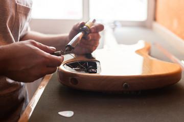 Man fixing a electric guitar