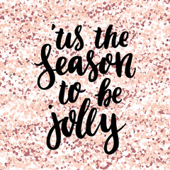 Merry Christmas quote: This is the season to be jolly, on a pink gold glitter background. It can be used for card, mug, brochures, poster, t-shirts, phone case etc.