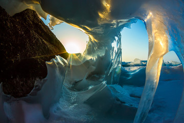 Transparent blue icicle ice cave in Lake Baikal
