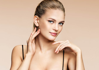 Charming woman with perfect skin. Photo of young woman on beige background. Beauty & Skin care concept