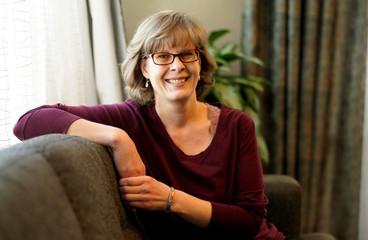 Kari Escher, former manager at Sunset Funeral Directors, poses for a portrait in Montrose