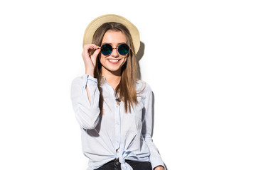 summer teen girl cheerful in panama and sunglasses enjoying isolated on white