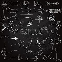 Hand drawn doodle arrows on blackboard