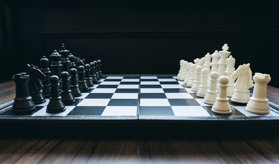 Beginning of the game, Two chess teams in front of different color white and black on the chessboard