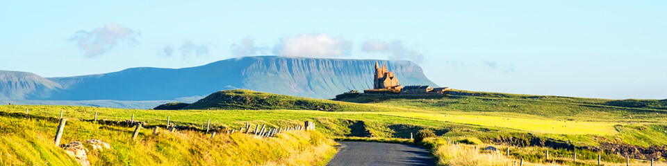 Famous Classiebawn Castle with Belbulbin mountain at the background in Sligo, Ireland