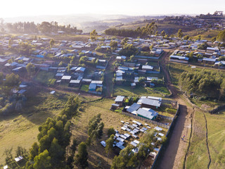 Aerial view of village and green farms in Ethiopia.