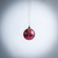 red Christmas ball isolated on a white background