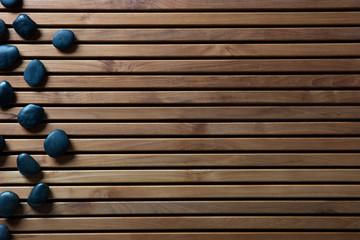 black massage pebbles for zen spa or shower, copy space