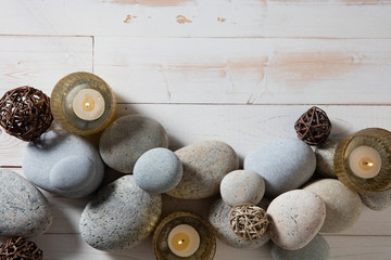 candles and mineral pebbles for mindfulness or serenity, flat lay