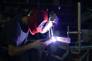Welders working at the factory.