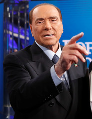 """Italy's former Prime Minister Berlusconi gestures during the taping of the television talk show """"Porta a Porta"""" (Door to Door) in Rome"""