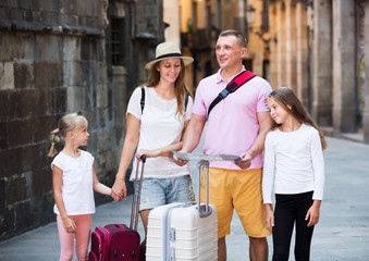 Family of tourists with map