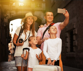 Travelers family taking selfie