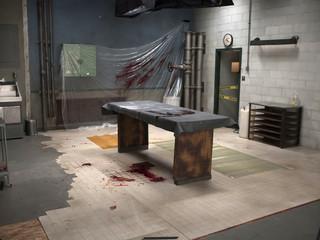 Staged post mortem room as a crime scene