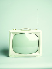 Green colour kitsch portable tv, green background