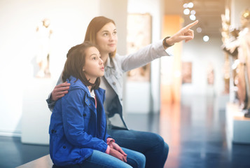 Mother and daughter in museum