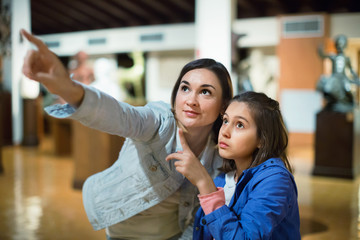 Mother and daughter enjoying expositions of previous centuries