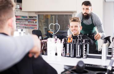 Hairdresser displaying result of work