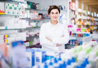 female pharmacist demonstrating assortment of pharmacy
