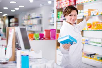 Adult female pharmacist suggesting useful drug