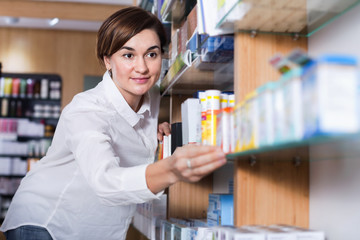 Female customer searching for reliable drug