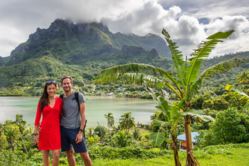Wall Mural - Bora Bora luxury cruise travel vacation tourists couple in front of Mt Otemanu in French Polynesia. Tahiti getaway holiday people visiting the island during cruise excursion tour.
