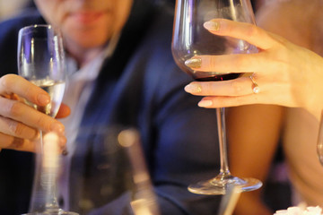 Spoed Foto op Canvas The conversation of a man and a woman with a glass of wine in a restaurant