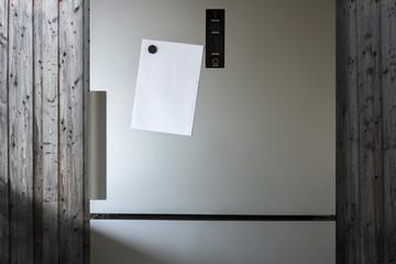 Empty Paper Sheet On Fridge Door - Infront Of Wooden Wall