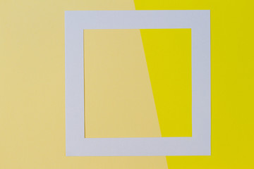 Empty white frame on two tones yellow background with copy space