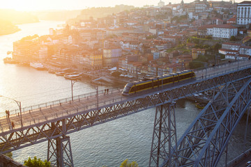 Bird's-eye view of Dom Luis I bridge, Douro river and Ribeira in Porto, Portugal.