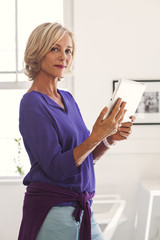 Portrait of Caucasian woman holding digital tablet